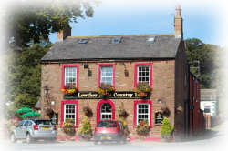 A photograph of the front of the Lowther Arms Country Inn